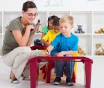 Teacher and preschool students2_teacher-helping-kindergarten-s-8813857