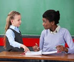 Teacher and Elem Student_Young-African-American-female--47379178